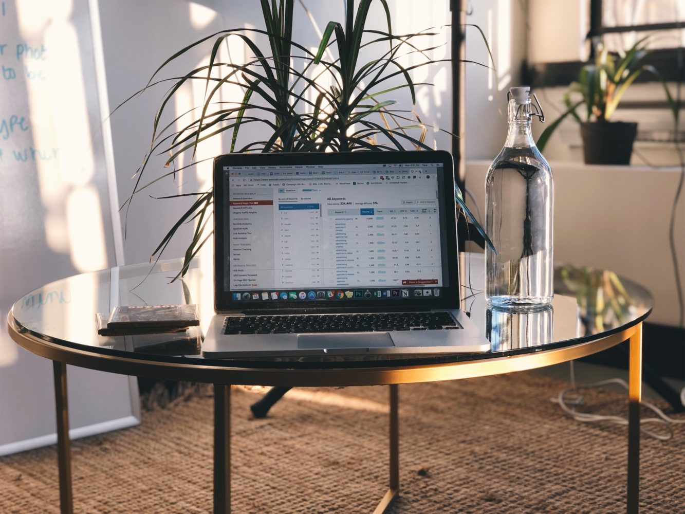 SEO Keyword Research Best Practices, Computer on coffee table in office with spreadsheet
